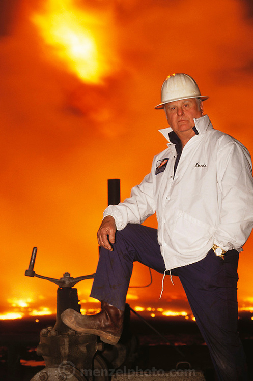 Boots Hansen of Boots & Coots Inc. In March, 1991, heads of the three Texas oil well fire fighting companies made their first trip to Kuwait to survey the damage of the burning oil fields set ablaze by retreating Iraqi troops in February. Here in the Al Burgan field in mid afternoon, it was as dark as a moonless night due to the heavy thick smoke. The only light came from the more than 300 flaming oil wells and the truck headlights. It was raining soot and unburned oil. It was estimated that 5 or 6 million barrels of oil were being lost every day in this field alone. Huge oil lakes were forming.