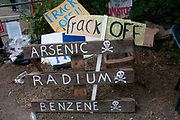 Balcombe, West Sussex. Site of Cuadrilla drilling. Demonstration against fracking 18.08.2013. At the site entrance signs saying Frack off, Arsenic, Radium, Benzene.