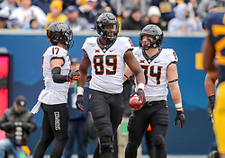 Nov 23, 2019; Morgantown, WV, USA; Oklahoma State Cowboys tight end Jelani Woods (89) catches a touchdown pass and celebrates with teammates during the first quarter against the West Virginia Mountaineers at Mountaineer Field at Milan Puskar Stadium. Mandatory Credit: Ben Queen-USA TODAY Sports