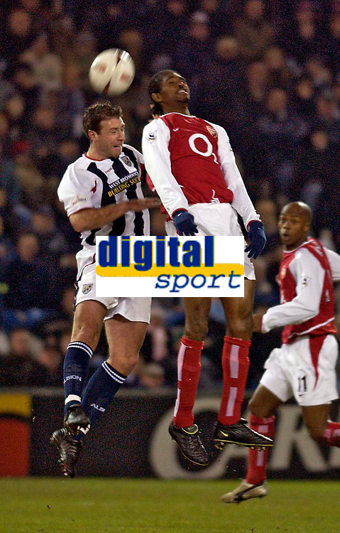 Photo. Jed Wee.<br /> West Bromwich Albion v Arsenal, Carling Cup, The Hawthorns, West Bromwich. 16/12/2003.<br /> Arsenal goalscorer Nwankwo Kanu (R) and West Brom's Sean Gregan jump for a high ball.