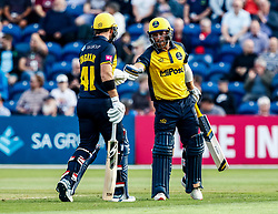 David Lloyd of Glamorgan celebrates a four with team-mate  Colin Ingram<br /> <br /> Photographer Simon King/Replay Images<br /> <br /> Vitality Blast T20 - Round 1 - Glamorgan v Somerset - Thursday 18th July 2019 - Sophia Gardens - Cardiff<br /> <br /> World Copyright © Replay Images . All rights reserved. info@replayimages.co.uk - http://replayimages.co.uk