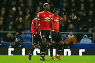Anthony Martial of Manchester United (r) celebrates with his teammates after scoring his teams 1st goal. Premier league match, Everton v Manchester Utd at Goodison Park in Liverpool, Merseyside on New Years Day, Monday 1st January 2018.<br /> pic by Chris Stading, Andrew Orchard sports photography.