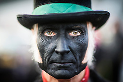 DATE CORRECTION. IMAGES SHOT 14/01/2017 © Licensed to London News Pictures. 14/01/2017. Whittlesey UK. Picture shows a member of the Old Glory Molly dancers at the 38th Whittlesey Straw Bear Festival this weekend. In times past when starvation bit deep the ploughmen of the area where drawn to towns like Whittlesey, They knocked on doors begging for food & disguised their shame by blackening their faces with soot. In Whittlesey it was the custom on the Tuesday following Plough Monday to dress one of the confraternity of the plough in straw and call him a Straw Bear. The bear was then taken around town to entertain the folk who on the previous day had subscribed to the rustics, a spread of beer, tobacco & beef. The bear was made to dance in front of houses & gifts of money, beer & food was expected. Photo credit: Andrew McCaren/LNP