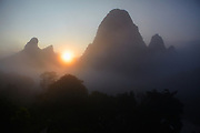 Karst rock formations in the morning mist on the Li River, Yangshuo, China