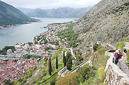 A path follows the fortifications across the slopes high above the UNESCO-listed old town of Kotor, leading to the fortress of Sv Ivan. Boka Kotorska (Bay of Kotor), Montenegro