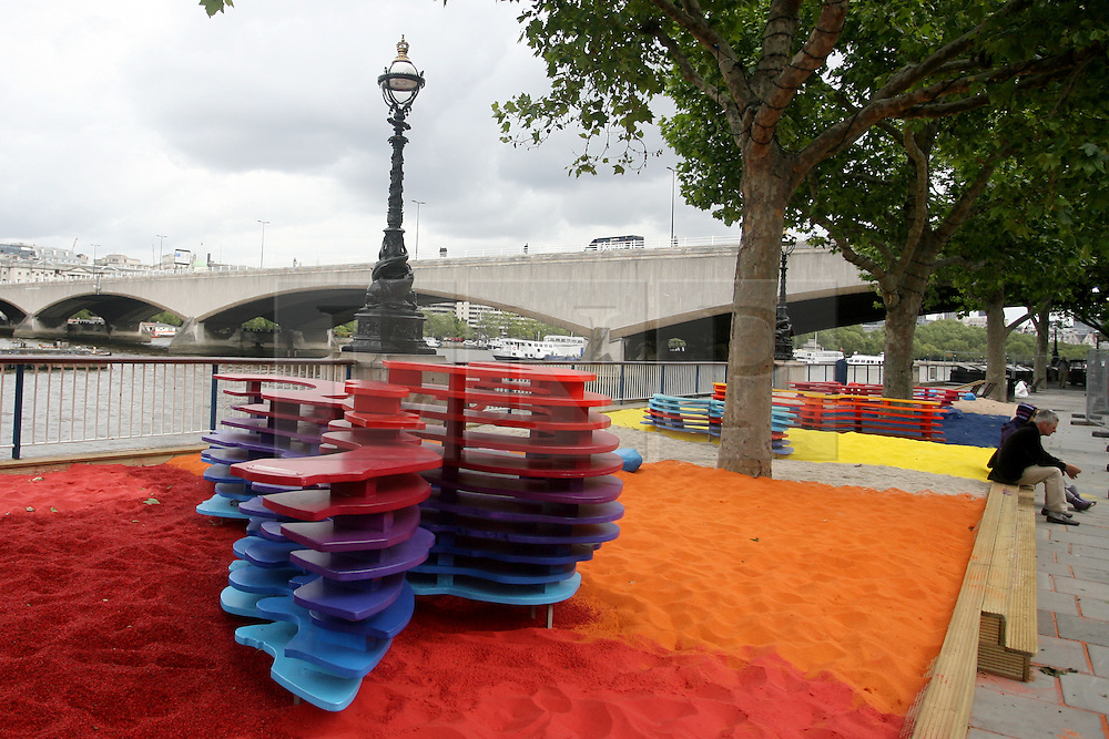 © Licensed to London News Pictures. 15/06/2012. London,Britain. Polish sculptor Adam Kalinowski (pictured) poses in front of London's Southbank Centre as the riverside was transformed into a Rainbow Park. A multicoloured sand installation open for the duration of the summer-long Festival of the World . Photo credit : Thomas Campean/LNP
