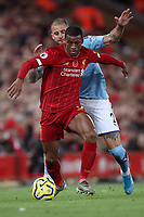 Football - 2019 / 2020 Premier League - Liverpool vs. Manchester City<br /> <br /> Georginio Wijnaldum of Liverpool and Kyle Walker of Manchester City, at Anfield.<br /> <br /> COLORSPORT/PAUL GREENWOOD