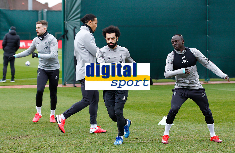 Football - 2019 / 2020 season - Liverpool training & press conference pre-Atletico Madrid<br /> <br /> Mohamed Salah of Liverpool warns up with Naby Keita and Virgil van Dijk during today's open training session at Melwood ahead of tomorrow's Champions League match against Atletico, at Anfield.<br /> <br /> COLORSPORT/ALAN MARTIN
