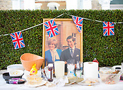An old framed photograph of Prince Charles and Princess Diana during a street party on the 1st August 2015 in South London in the United Kingdom.