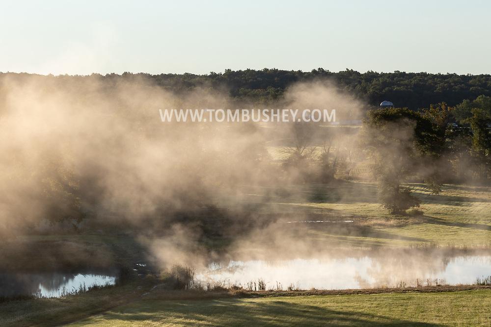 Morning mist over a farm pond in Slate Hill, on Octd. 2, 2021.