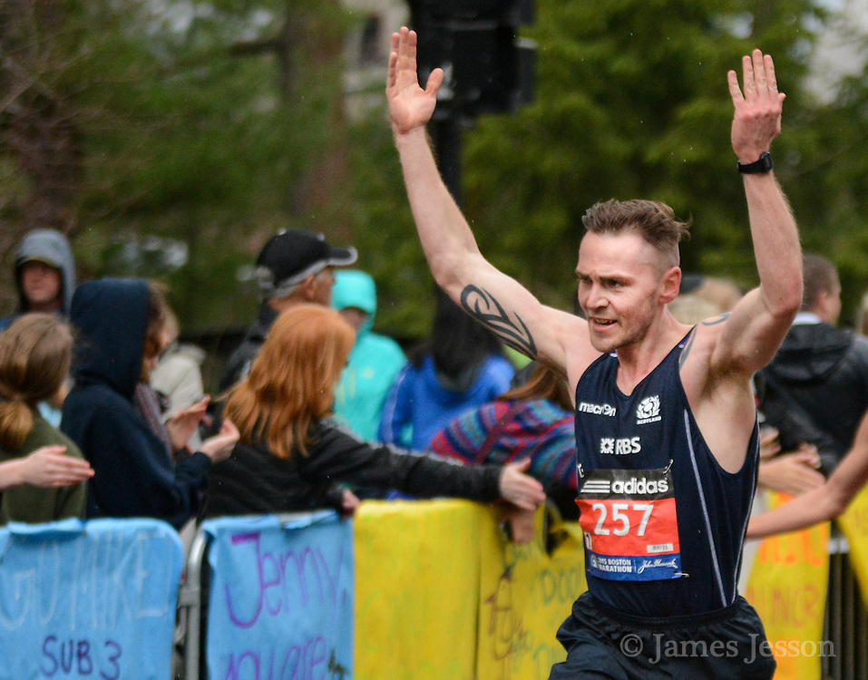 Lee Muir, from Great Britain, motions to the crowd during the 119th running of the Boston Marathon along Central Street in Wellesley, April 20, 2015.   (Wicked Local Photo/James Jesson).