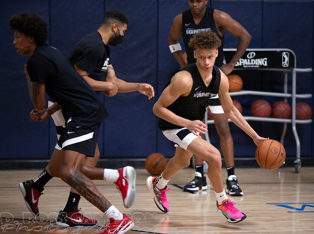 G League Ignite's Dyson Daniels drives past coach Nick Hamilton during a workout with the team on Tuesday, Sept. 28, 2021 in Walnut Creek, Calif.