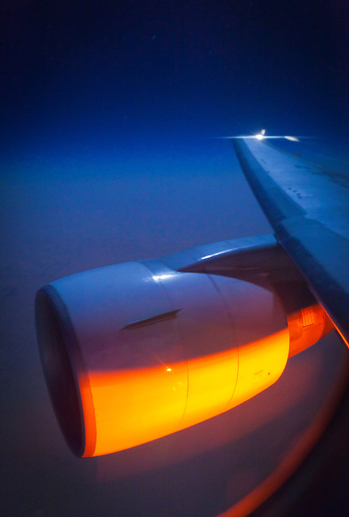 The wing and engine of a Boeing 767-ER, somewhere over North Africa.