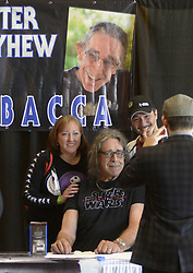 Jan. 10, 2016 - U.S. - ASEC  --  Peter Mayhew, the actor who portrays Chewbaca in the Star Wars movies, center, poses for photos with Christina and David Miranda of Albuquerque during the Albuquerque Comic Con at the Albuquerque Convention Center on Sunday, January 10, 2016. (Credit Image: © Greg Sorber/Albuquerque Journal via ZUMA Wire)