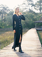 Image of Nicole walking on an old wooden walkway over a swamp in South Carolina. We created this images for Boston Proper.