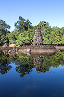 """Neak Pean """"The entwined serpents"""" is built on an artificial island with a Buddhist temple on a circular island and was constructed during the reign of King Jayavarman VII.  The temple and lake represent Anavatapta - a mythical lake in the Himalayas - with waters that are believe to cure illnesses. Neak Pean was set up for medical purposes.  The ancients believed that going into the pools would cure diseases based on the ancient Hindu belief of balance. Four connected pools represent Water, Earth, Fire and Wind. The stone statues in pavilions are meant to represent the heads of the Four Great Animals."""