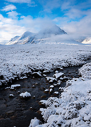 Winter view of snow covered Buachaille Etive Mor mountain and River Coupall in Glen Coe, Scotland, UK