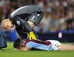 "Aston Villa's Ciaran Clark has to leave the pitch due to a head injury  - Photo mandatory by-line: Joe Meredith/JMP - Tel: Mobile: 07966 386802 21/08/2013 - SPORT - FOOTBALL - Stamford Bridge - London - Chelsea V Aston Villa - Barclays Premier League - EDITORIAL USE ONLY. No use with unauthorised audio, video, data, fixture lists, club/league logos or ""live"" services. Online in-match use limited to 45 images, no video emulation. No use in betting, games or single club/league/player publications"