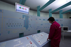 An employee monitors the the production of electricity in the control room at the Essent Energie power station, in Geertruidenberg, Netherlands, on Monday March 22, 2010. Essent Energie is owned by RWE AG. (Photo © Jock Fistick).