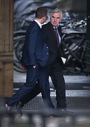 © Licensed to London News Pictures. 05/01/2016. London, UK. Labour Party Shadow Chancellor John McDonnell (R) walks to parliament after party leader Jeremy Corbyn anounced changes to his shadow cabinet. Photo credit: Peter Macdiarmid/LNP
