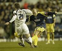 Photo: Aidan Ellis.<br /> Leeds United v Derby County. Coca Cola Championship. 09/12/2006.<br /> Leeds Shaun Derry (L) challenges Derby's Seth Johnson