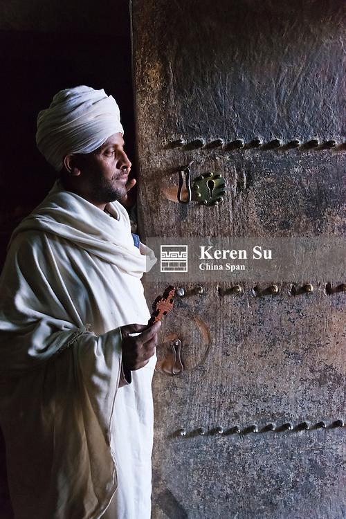 Pilgrim in Yemrehanna Kristos Church, built inside a natural cavern, Lalibela, Ethiopia
