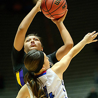 031015  Adron Gardner/Independent<br /> <br /> Kirtland Central Bronco Krystal Sheeka (33) attempts a field goal over St. Michael's Horsemen Lainie Serna (4) during the New Mexico state basketball tournament at The Pit in Albuquerque Tuesday.