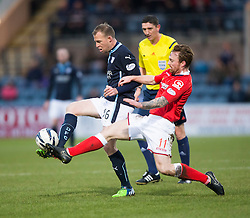 Dundee's David Clarkson and Ross County's Craig Curran. <br /> Half time : Dundee 0 v 0 Ross County, SPFL Premiership game player 4/1/2015 at Dundee's home ground Dens Park.