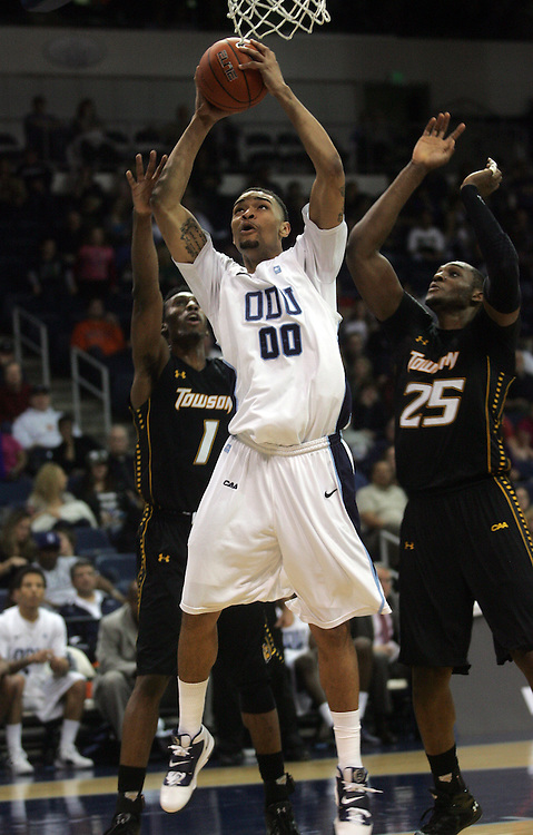Jan 7, 2012; Norfolk, VA, USA; Old Dominion Monarchs forward Jason Pimentel (0) shoots against the Towson Tigers forward Marcus Damas (1) and forward Robert Nwankwo (25) at the Ted Constant Convocation Center. Mandatory Credit: Peter Casey-US PRESSWIRE