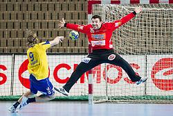 Dean Bombac of Koper vs Primoz Prost of Goeppingen during handball match between RK Cimos Koper and Frisch Auf Goeppingen (GER) in 3rd Round of EHF Cup 2012/2013, on February 23, 2013 in Arena Bonifika, Koper, Slovenia. Goeppingen defeated Cimos Koper 39-36. (Photo By Vid Ponikvar / Sportida)