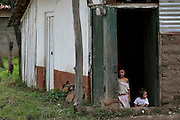 Two children sit at on the threshold of their families home.  Honduras is considered the third poorest country in the Western Hemisphere (Haiti, Nicaragua). With over 50% of the population living below the poverty line and 28% unemployed, Hondurans frequently turn to illegal immigration as a solution to their desperate situation. The Department of Homeland Security has noted an 95% increase in illegal immigrants coming from Honduras between 2000 and 2009, the largest increase of any country.