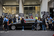 Protesting about the government in Camaroon  ( presumably next to the Camaroon's representative ) outside  The Commonwealth Service, Westminster Abbey, London, 11 March 2019