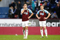 Burnley's Jack Cork appears dejected after Leicester City's Wes Morgan (not in picture) scores his side's second goal of the game during the Premier League match at Turf Moor, Burnley.