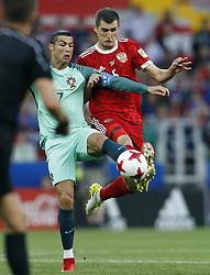 June 21, 2017 - Cristiano Ronaldo de Portugal disputa bola com Viktor VASIN da Rússia durante partida entre Rússia x Portugal válida pela segunda rodada da Copa das Confederações 2017, nesta quarta-feira (21), realizada no Estádio do Spartak (Otkrytie Arena), em Moscou, na Rússia. (Credit Image: © Rodolfo Buhrer/Fotoarena via ZUMA Press)
