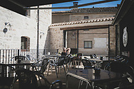Matt, from England, takes a break from his Camino at the cafe attached to La Casa de Beli, an albergue in the village of Taradjos, just a few kilometers outside Burgos. (June 14, 2018).<br />