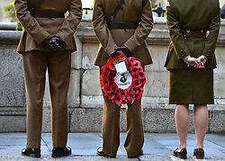 © Licensed to London News Pictures. 11/11/2012. City of London, UK People gather at a service of remembrance to remember those killed in action during conflict fighting for the UK. The Stock Exchange, today 11 November 2012. Both Armistice Day and Remembrance Sunday fall of the same day this year. Photo credit : Stephen Simpson/LNP
