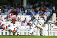 Ben Foakes of Surrey dives for the crease during the Specsavers County Champ Div 1 match between Surrey County Cricket Club and Kent County Cricket Club at the Kia Oval, Kennington, United Kingdom on 7 July 2019.