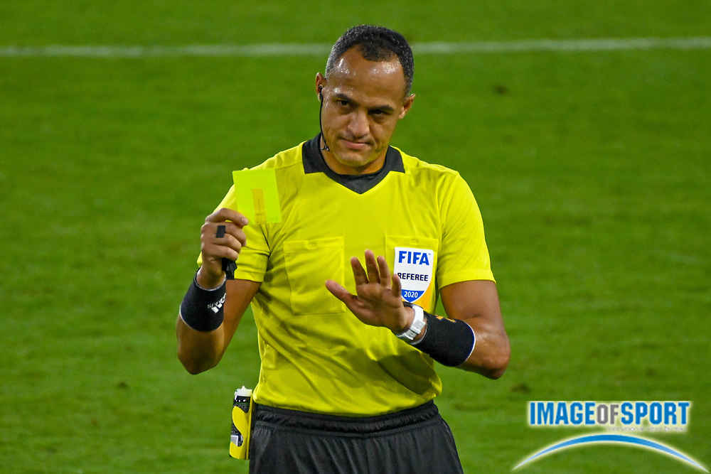 Match referee Ismail Elfath issues a yellow card to San Jose Earthquakes forward Cristian Espinoza (10) during a MLS soccer game, Sunday, Sept. 27, 2020, in Los Angeles. The San Jose Earthquakes defeated LAFC 2-1.(Dylan Stewart/Image of Sport)