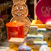 A gingerbread easter bunny on display in a cake shop in the historic center of Bruges, Belgium.