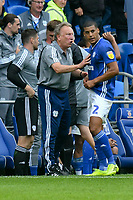 Football - 2019 / 2020 Sky Bet (EFL) Championship - Cardiff City vs. Luton Town<br /> <br /> Cardiff City manager Neil Warnock on the touchline speaks to Lee Peltier of Cardiff City after Cardiff take the lead with minutes remaining, at Cardiff City Stadium.<br /> <br /> COLORSPORT/WINSTON BYNORTH