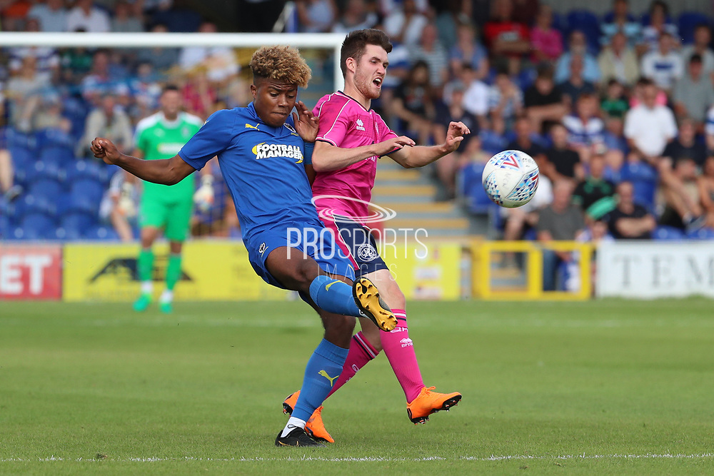 AFC Wimbledon midfielder Ossama Ashley (36) battles for possession during the Pre-Season Friendly match between AFC Wimbledon and Queens Park Rangers at the Cherry Red Records Stadium, Kingston, England on 14 July 2018. Picture by Matthew Redman.