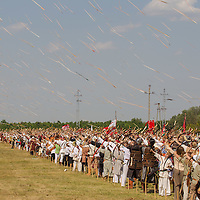 People dressed in period costumes participate in the 6th Arrow Rain event celebrating Hungarian war traditions in Opusztaszer, Hungary on June 30, 2012. ATTILA VOLGYI