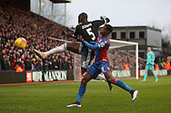Kurt Zouma of Chelsea challenges Wilifried Zaha of Crystal Palace. Barclays Premier League match, Crystal Palace v Chelsea at Selhurst Park in London on Sunday 3rd Jan 2016. pic by John Patrick Fletcher, Andrew Orchard sports photography.