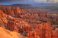 Thousands of delicately carved spires rise in brilliant color from the amphitheaters of Bryce Canyon National Park. Millions of years of wind, water and geologic mayhem have shaped and etched the pink cliffs at Bryce, which isn't actually a canyon but the eastern slope of the Paunsaguant Plateau.