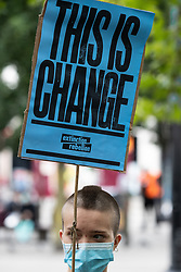 "© Licensed to London News Pictures. 30/08/2020. Manchester, UK. A protester hold a placard reading ""This is Change"" . Protesters and campaigners hold a combined Extinction Rebellion and Black Lives Matter protest in Manchester City Centre , during which statues and memorials are rededicated with new historical context highlighting the slave trade . Photo credit: Joel Goodman/LNP"