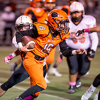 Photo - Jeffery Jones<br /> <br /> Gallup Bengal back-up quarterback Isaiah Reece (19) carries the ball Friday night while playing against the Aztec Tigers at DiPaulo Memorial Stadium.