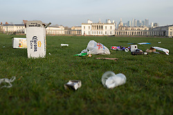 © Licensed to London News Pictures. 31/03/2021. London, UK. Rubbish has been left  in Greenwich Park after hundreds of people visited the park to enjoy sunny weather and take advantage of new lockdown rules that allow groups of six to meet outside. Photo credit: George Cracknell Wright/LNP