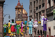 Paper doll effigies hang in the Plaza Allende in preparation for the Burning of Judas Easter-time ritual marking the end of Holy Week April 1, 2018 in San Miguel de Allende, Mexico.