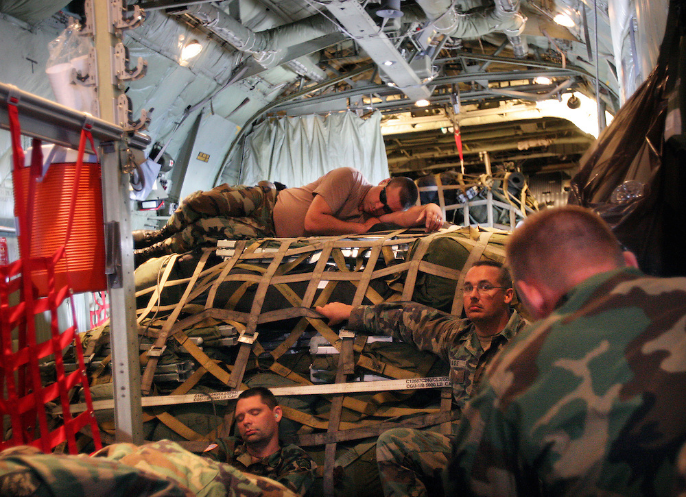 Oregon National Guard troops in the 1186th Military Police Company try to get some sleep on a crowded C-130 propeller-driven ride home from New Orleans after helping the city recover from Hurricane Katrina. Photographed September 12, 2005. (Thomas Patterson / Statesman Journal)