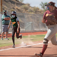 Thoreau's Jayleen Benally steals home during their varsity softball game against Rehoboth Thursday at Ford Canyon Park in Gallup.